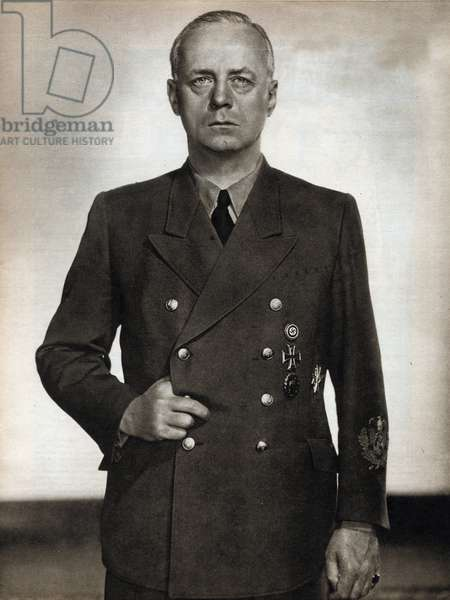 """Portrait of Joachim von Ribbentrop (1893-1946), Minister of Foreign Affairs of the Third Reich from 1938 to 1945, he was responsible for the German-Sovietic Pact (1939) of Non-Aggression and the Steel Pact (1939) for the rapprochement between Hitler and Mussolini, then he pushed to the end of the war with Russia in 1941 - Photography in """"die Woche"""""""" 28 /04/1943 - Selva Collection"""