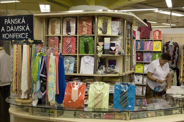 Stand of ties and shirts at the Kotva department store in Prague, Czech Republic. Photography 2009