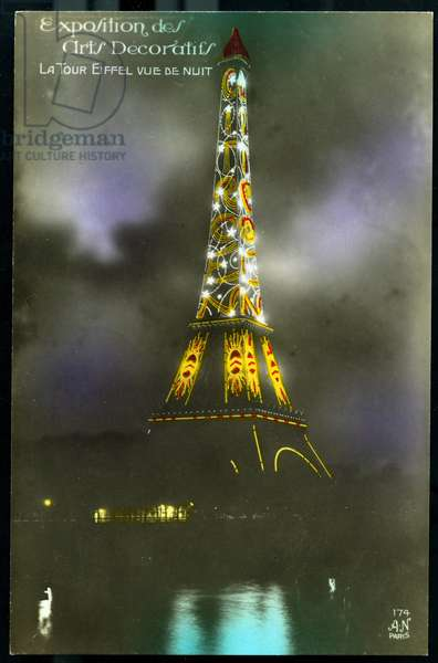 The Eiffel Tower illuminated with an advertisement for the Citroen automobile company - Paris, France, Exhibition of decorative arts: the Eiffel Tower illuminated with a Citroen advertisement, 1925