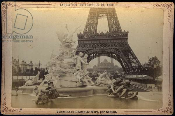 France, Ile-de-France, Paris (75): The fountain of the Champ de Mars by Coutan with the Eiffel Tower in the background, 1889