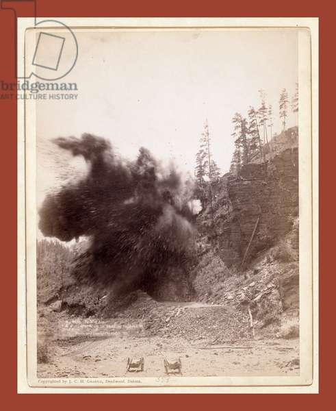 In Mid Air. A Wonderful Blast in Building Railroad to Deadwood