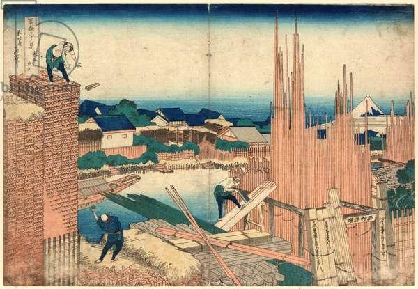 Honjo Tatekawa, Takekawa in Edo. [1833 or 1834], 1 Print : Woodcut, Color ; 25.6 X 37.3 ., Print Shows a Man Cutting Boards and Two Men Building a Wall.