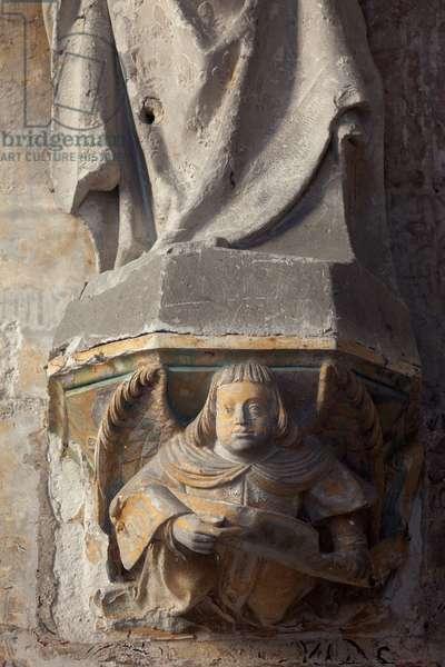 Church (Église Saint-Sauveur du Petit-Andely). Interior. Statue of a woman. Stone. 15th century. Detail of the socle.