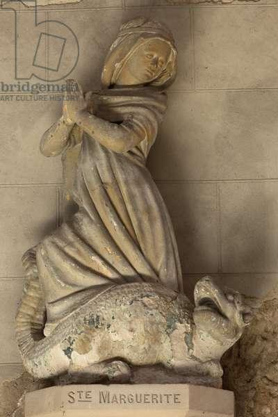 Church (Église Saint-Sauveur du Petit-Andely). Interior. The choir. A statue. Saint Margaret. Stone. 15th century.