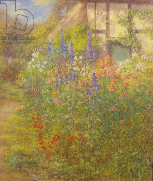 Lilies, Delphiniums and Poppies in the Garden of the Artist's Cottage at Ashton-under-Hill near Evesham, Worcestershire