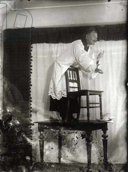 Mucha posing as Jan Hus for 'Master Jan Hus Preaching at the Bethlehem Chapel' (The Slav Epic cycle No.8, 1916), c.1915-16 (b/w photo)