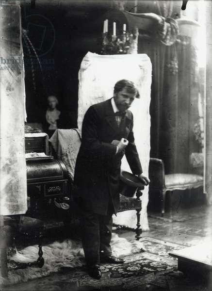 Self portrait, posing with a silk hat in the studio, Rue du Val de Grâce, Paris, c.1896 (b/w photo)
