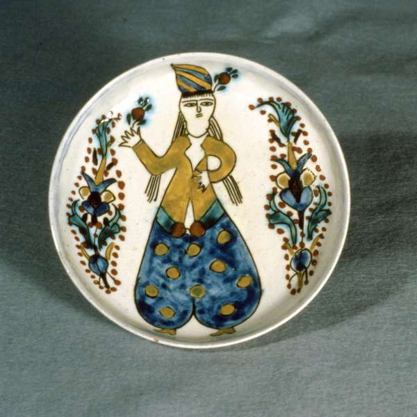 J1 Saucer with decoration of a woman in Turkish trousers holding a red flower, from Kutahya, Armenia, c.1750-1800 (ceramic)