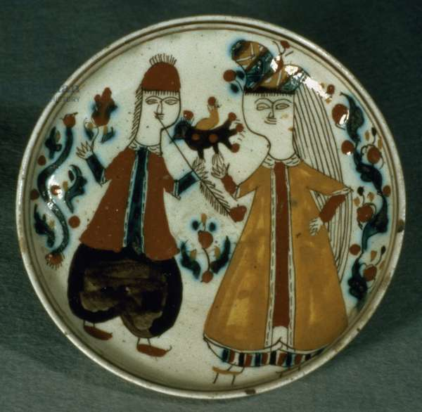 J14 Saucer or dish depicting and man and a woman in Turkish costume, from Kutahya, Armenia, c.1750-1800 (ceramic)