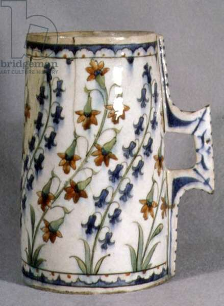 S2 Tankard, with decoration of eight tall stylised sprays of blue harebells and other hanging flowers, from Iznik in Turkey, c.1560 (ceramic)