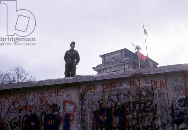 Fall of the Berlin Wall: a miltaire on the Wall. November 1989.
