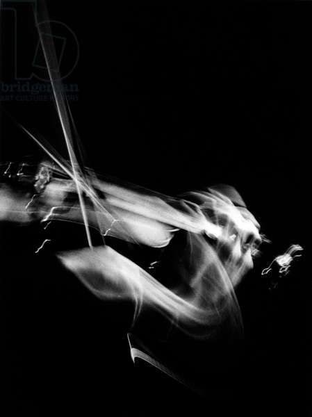 Artistic picture of a violinist in motion.