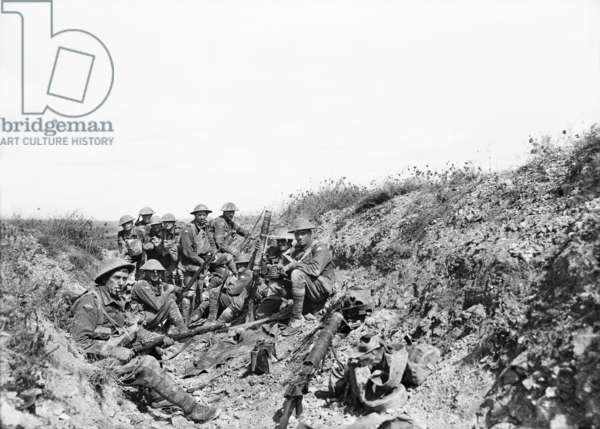 Lieutenant A. V. Sedgwick MC and some of his party from the 24th Battalion, awaiting the lifting of the artillery barrage on Mont St Quentin, photographed a few minutes before moving out of the trench to engage in the renewed attack on the Crater at 1.30 p.m. on that date, 1 September 1918 (b/w photo)