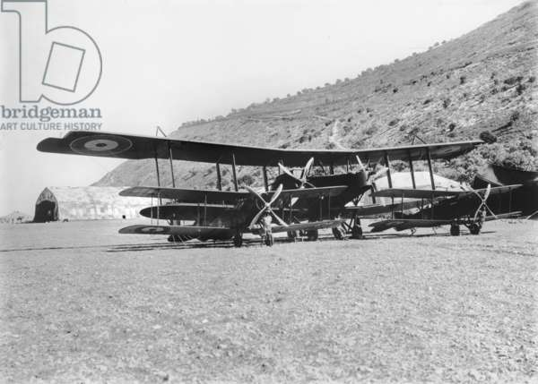 A Handley-Page 0/400 aircraft with some Bristol Fighter machines at the aerodrome of the Australian Flying Corps at Haifa.  Captain Ross Macpherson Smith frequently piloted this aircraft, 1918 (b/w photo)