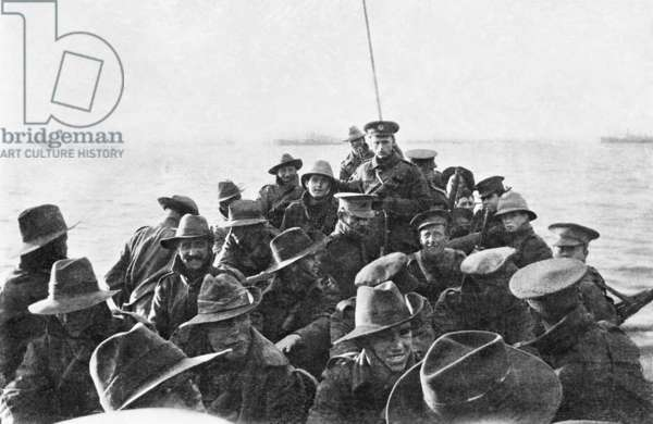 A view looking aft of lifeboat carrying unidentified men of the Australian 1st Divisional Signal Company, as they are towed towards Anzac Cove at 6 am on the day of the landing, 25 April 1915 (b/w photo)