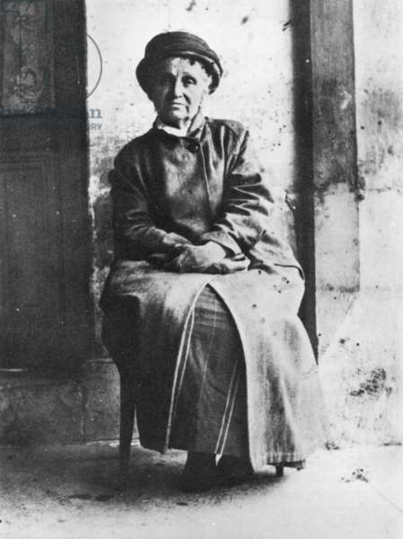 Camille Claudel sitting on chair, 1935 (b/w photo)