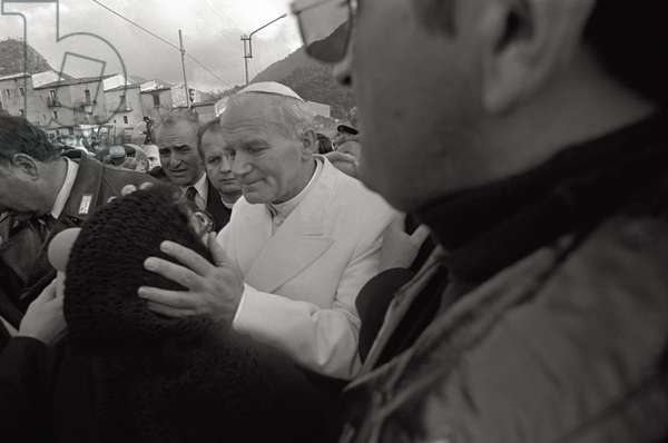 Pope John Paul II caresses the face of a woman, 1980 (b/w photo)