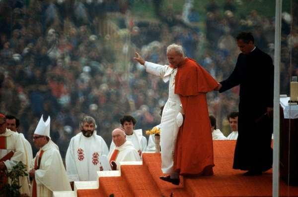 Pope John Paul II greeting Christian believers