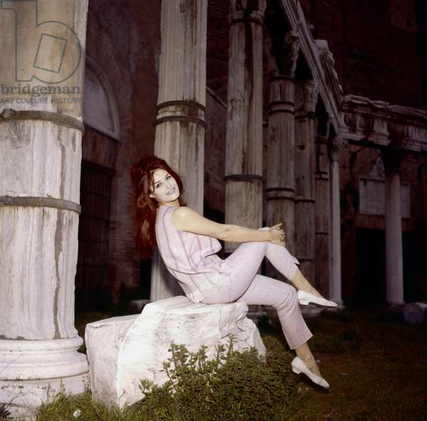 Dalida sitting in front of a colonnade, Rome, Italy