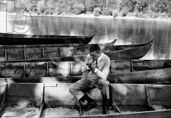 Enrico Emanuelli lighting a cigarette, Italy