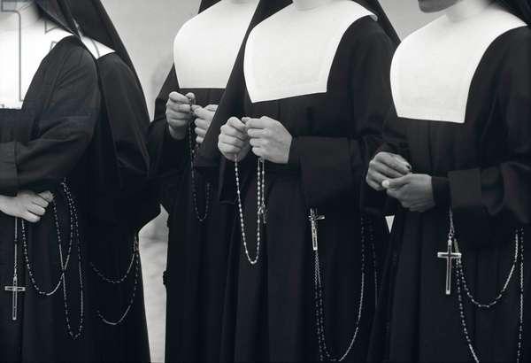 Nuns saying their rosary