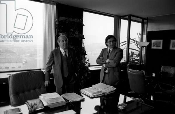 Luigi Lucchini in his office with his son Giuseppe