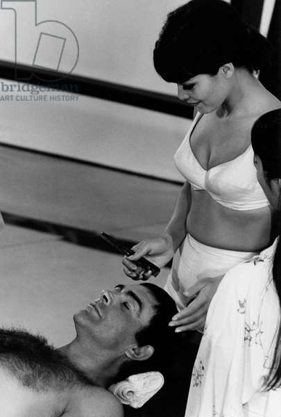Jeanne Roland takes care of Sean Connery, 1966 (b/w photo)