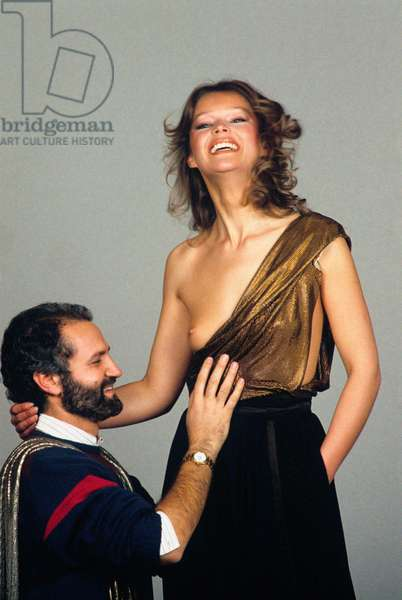 Gianni Versace with a model