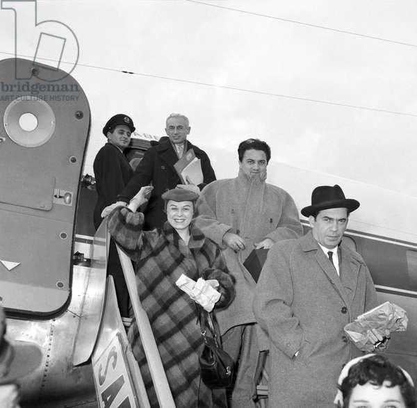 Giulietta Masina and Federico Fellini getting off the aircraft, Italy, 1954 (b/w photo)