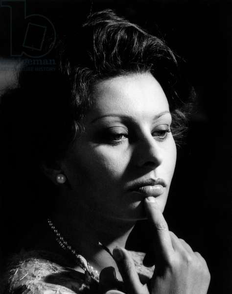 Close-up of a thoughtful Sophia Loren in a scene of the movie 'Marriage Italian Style', 1964 (b/w photo)