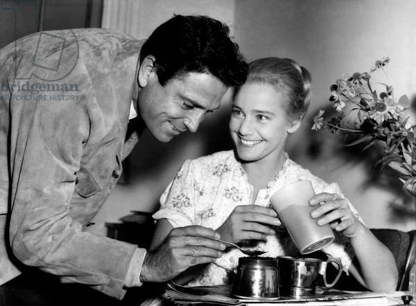 Raf Vallone and Maria Schell making the coffee, 1956 (b/w photo)