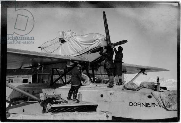 Roald Amundsen checking an aircraft during his South Pole expedition, Antarctica