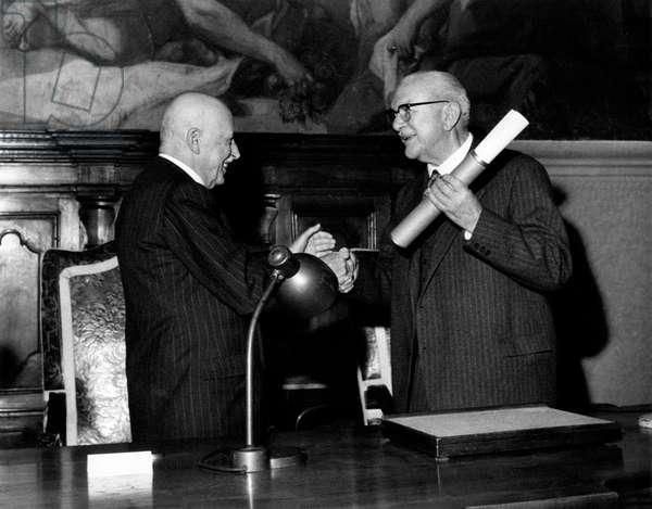 Alberto Pirelli congratulating Luigi Emanueli