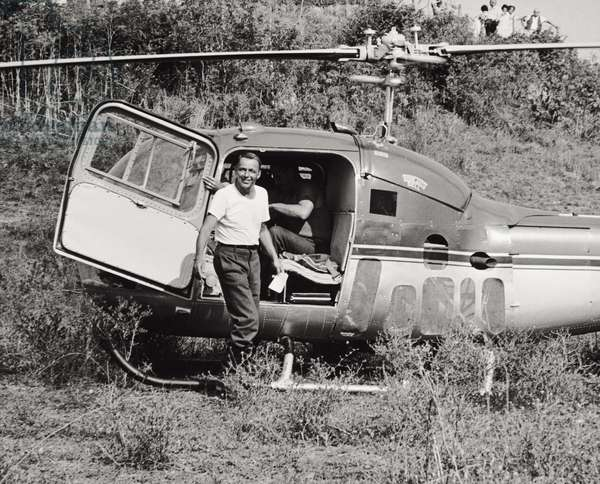 Frank Sinatra next to a helicopter (b/w photo)