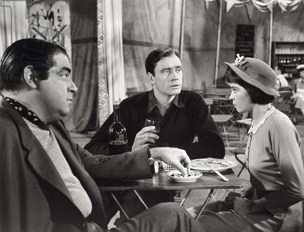 Mel Ferrer, Leslie Caron and Kurt Kasznar in a scene form the movie