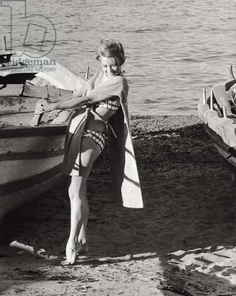 Angie Dickinson on the beach, 1961 (b/w photo)