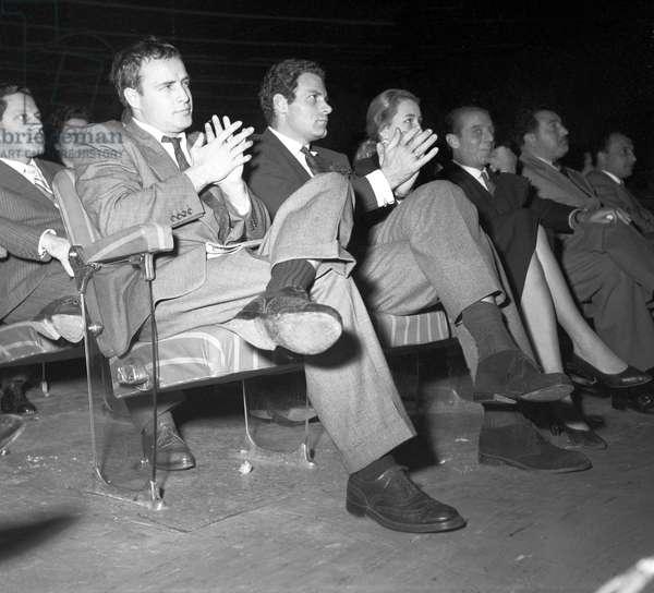 Marlon Brando clapping hands at Sistina Theatre, 1954 (b/w photo)