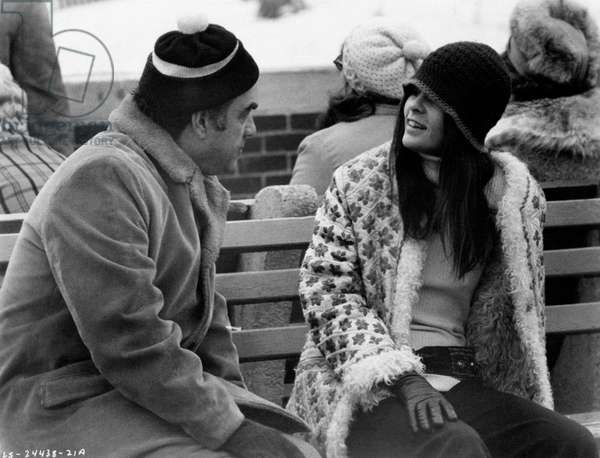 Ali MacGraw and Howard G. Minskyin sitting on a park bench; they are talking, 1970 (b/w photo)