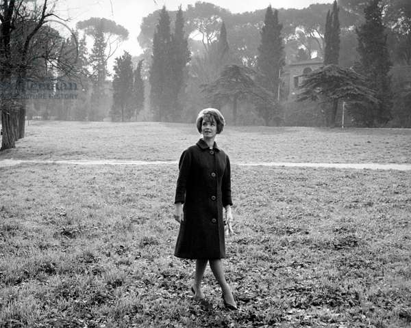 Aba Cercato walking on the grass, in a park, 1961 (b/w photo)