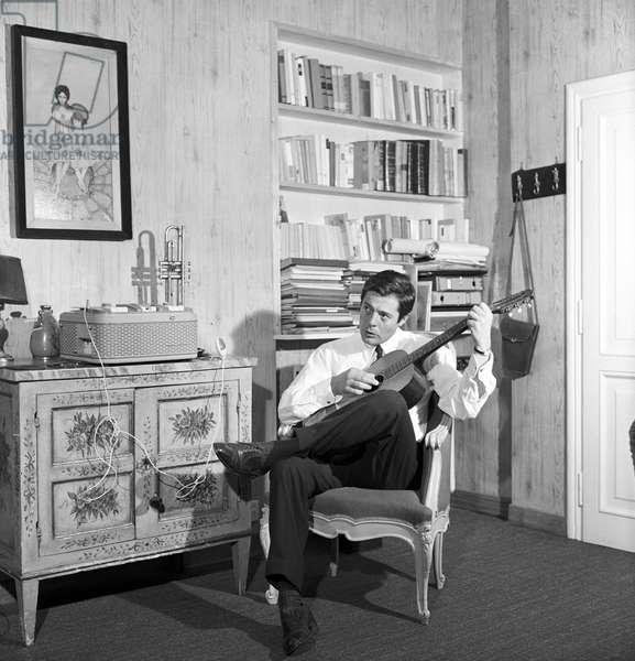 Marcello Mastroianni playing guitar, Italy, 1962 (b/w photo)