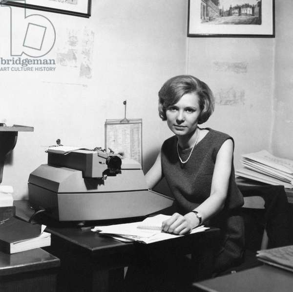 The editorial assistant of the weekly magazine Epoca posing in front of the typewriter, She was the first people to know about the attempt on U,S, President John Fitzgerald Kennedy's life, Milan, 1963 (b/w photo)