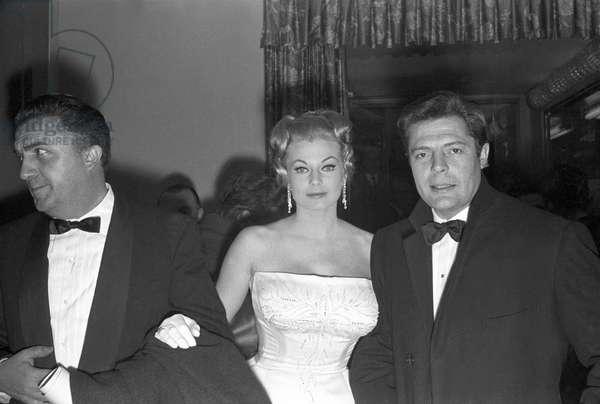 Federico Fellini, Marcello Mastroianni and Anita Ekberg at the premiere of the film La Dolce Vita, Italy, 1960 (b/w photo)