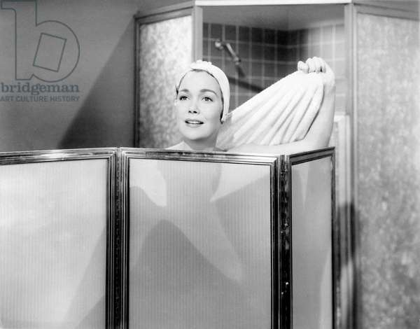 Jane Wyman behind a screen while she is wiping herself after a shower