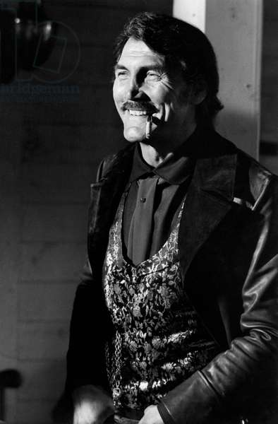Jack Palance on the set of the film 'Bulldozer is back Amigo'