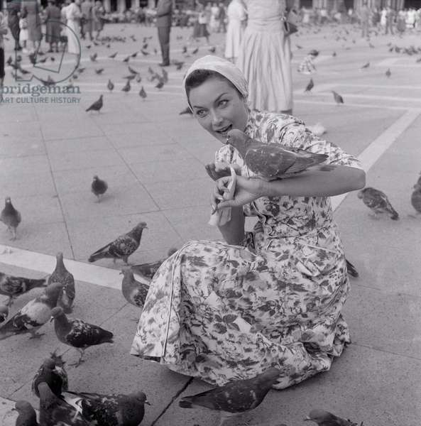 Gianna Maria Canale with pigeons, Italy, 1955 (b/w photo)