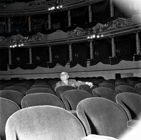 Alberto Savinio sitting at La Scala Theatre, Milan, Italy