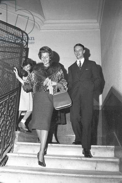 Rita Hayworth climbing down the stairs, 1961 (b/w photo)