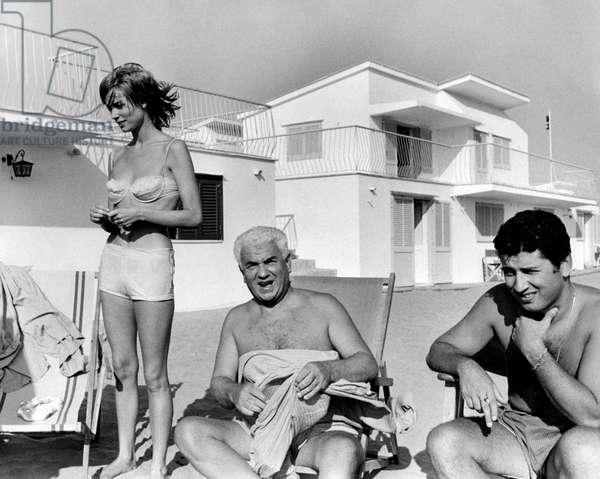 Gino Cervi, Antonio Cervi and Elsa Martinelli on the seashore, 1960s (b/w photo)