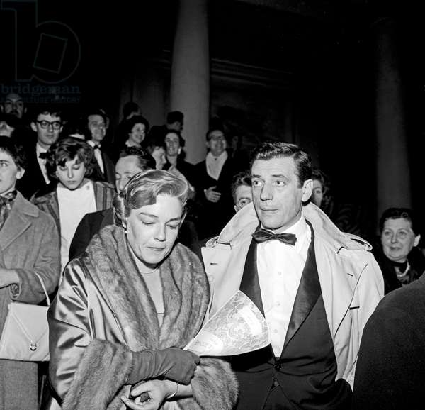 Yves Montand and Simone Signoret leaving a theatre, Rome, Italy, 1958 (b/w photo)