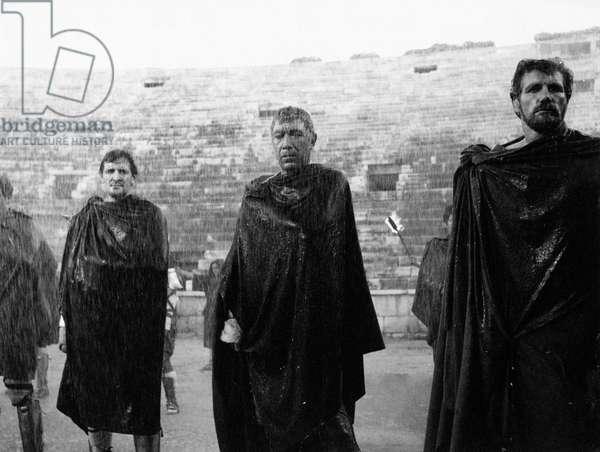 Anthony Quinn interprets an ancient Roman in the rain, 1961 (b/w photo)